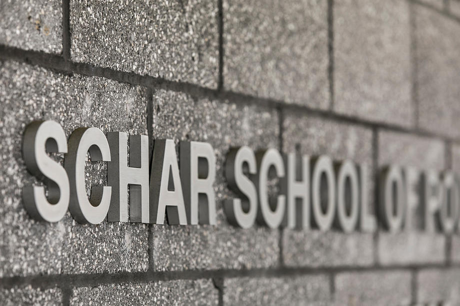 Photo of the Schar School name on a building